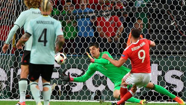 TOPSHOT - Wales' forward Hal Robson-Kanu (R) scores a goal during the Euro 2016 quarter-final football match between Wales and Belgium at the Pierre-Mauroy stadium in Villeneuve-d'Ascq near Lille, on July 1, 2016. / AFP PHOTO / PHILIPPE HUGUENPHILIPPE HUGUEN/AFP/Getty Images