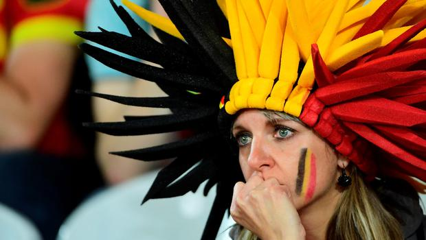 A Belgium supporter reacts after the Euro 2016 quarter-final football match between Wales and Belgium at the Pierre-Mauroy stadium in Villeneuve-d'Ascq near Lille, on July 1, 2016. Wales won the match 3-1. / AFP PHOTO / EMMANUEL DUNANDEMMANUEL DUNAND/AFP/Getty Images