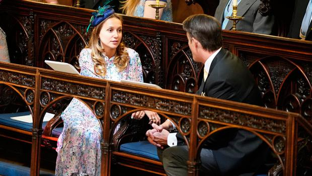 WINDSOR, UNITED KINGDOM - MAY 19:  Daisy Jenks and Benedict Mulroney take their seats in St George's Chapel at Windsor Castle before the wedding of Prince Harry to Meghan Markle on May 19, 2018 in Windsor, England. (Photo by Dominic Lipinski - WPA Pool/Getty Images)