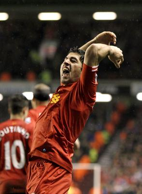 Liverpool's Luis Suarez celebrates scoring their fourth goal of the game during the Barclays Premier League match at Anfield