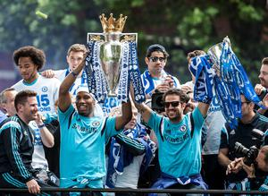 Chelsea's Didier Drogba (left) and Cesc Fabregas with the trophy during a parade to celebrate winning the Barclays Premier League, in London. PRESS ASSOCIATION Photo. Picture date: Monday May 25, 2015. See PA story SOCCER Chelsea. Photo credit should read: Daniel Hambury/PA Wire.