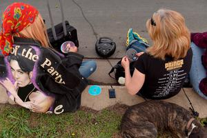 CHANHASSEN, MN - APRIL 21:  Sheila Clayton, left and Anna Horn, listen to their collection of Prince CD's  on their boombox outside of Paisley Park on April 21, 2016 in Chanhassen, Minnesota. Prince died earlier today at his Paisley Park compound at the age of 57. (Photo by Jules Ameel/Getty Images)