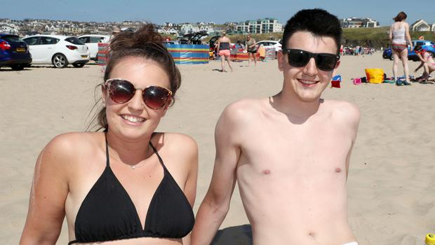 Press Eye - Weather Pictures - Portstewart Beach - 30th June 2018  Photograph by Declan Roughan  Katie Shearer and Joshua Reid from Ballyclare.