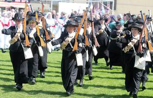 Northern Ireland- 26th April 2014 Mandatory Credit - Photo-Jonathan Porter/Presseye.  Parade in Larne to commemorate the Ulster Volunteer Force gun-running operation 100 years ago.  The UVF imported the guns to counteract the threat of Home Rule.  Many of those marching in the parade are in period costume.  The parade enters the field in Larne.