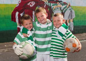 McBurney/Cliftonville v Celtic  Champion's League Knock-out stage between Belfast's Cliftonville FC against Glasgow's Celtic FC  Pictured a mural depicting the friendship between the two football clubs with young local children, L-R Jay, Conal & Tony  Pictured date: Wednesday 17th July 2013 Location: Essex Close, Belfast Credit: Liam McBurney/RAZORPIX Copyright: Liam McBurney/RAZORPIX  Liam McBurney +44 7837 685767 liammcburney.com
