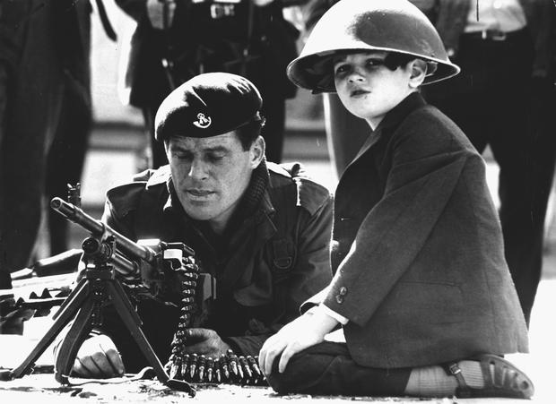 Army in Ulster 1969 | Library file dated 18/08/1969 | Ardoyne, Belfast. Soldier with young boy.
