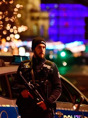 A policeman stands near the scene where a truck speeded into a christmas market in Berlin, on December 19, 2016 killing nine persons and injuring at least 50 people. / AFP PHOTO / John MACDOUGALLJOHN MACDOUGALL/AFP/Getty Images