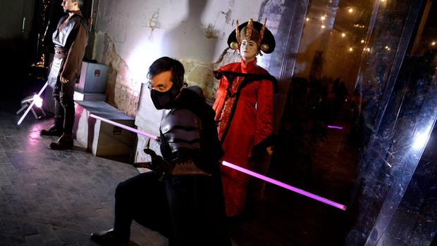 Party-goers wear Star Wars movie character's outfits during a party in owntown Rome on December 15, 2015 on the eve of the premiere of the Disney movie.     The latest installment of the Star Wars series opens in cinemas in France, Italy and other European countries at the start of a global rollout of the film, whose plot has been kept under wraps by producers Disney. / AFP / FILIPPO MONTEFORTEFILIPPO MONTEFORTE/AFP/Getty Images