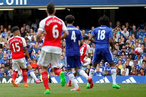 Chelsea's Belgian midfielder Eden Hazard's (2nd L) deflected shot leads to Chelsea's second goal during the English Premier League football match between Chelsea and Arsenal at Stamford Bridge in London on September 19, 2015. Chelsea won the game 2-0. AFP PHOTO / IAN KINGTON  RESTRICTED TO EDITORIAL USE. No use with unauthorized audio, video, data, fixture lists, club/league logos or 'live' services. Online in-match use limited to 75 images, no video emulation. No use in betting, games or single club/league/player publications.IAN KINGTON/AFP/Getty Images