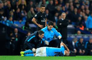 Manchester City's Sergio Aguero lies injured during the UEFA Champions League Quarter Final, Second Leg match at the Etihad Stadium, Manchester. Nigel French/PA Wire
