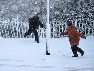 Pacemaker Press 08/12/2017 Young Boys play in the snow  in Crumlin , as heavy snow falls across  Northern Ireland on Friday morning, leaving difficult driving conditions for motorists and some schools closed. Pic Colm Lenaghan/ Pacemaker