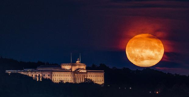 Harvest Moon rises over Stormont in Belfast, Northern Ireland on October 1, 2020. Photo by Stephen Henderson