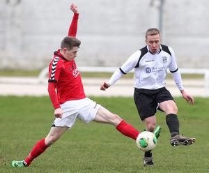 Action from Lisburn Distillery vs Larne in the Belfast Telegraph Championship one.