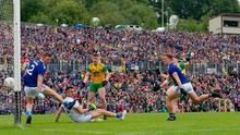 Kings of Ulster: Donegal's Jamie Brennan scores his side's opening goal despite Jason McLoughlin, goalkeeper Raymond Galligan and Padraig Faulkner's attempts