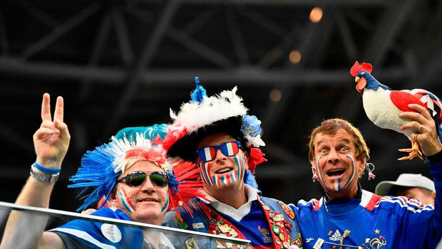France fans pose before the Russia 2018 World Cup semi-final football match between France and Belgium at the Saint Petersburg Stadium in Saint Petersburg on July 10, 2018. / AFP PHOTO / CHRISTOPHE SIMON / RESTRICTED TO EDITORIAL USE - NO MOBILE PUSH ALERTS/DOWNLOADS CHRISTOPHE SIMON/AFP/Getty Images