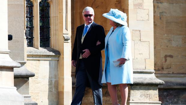 Sir Keith Mills and his wife Maureen Mills arrive at the wedding of Prince Harry to Ms Meghan Markle at St George's Chapel, Windsor Castle on May 19, 2018 in Windsor, England.  (Photo by Chris Jackson/Getty Images)