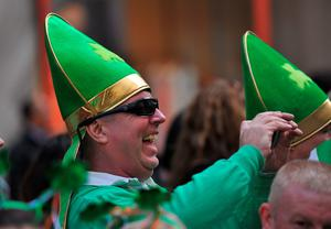 A parade participant cheers on 5th Avenue during the 255th New York City St Patrick's Day Parade on March 17, 2016. / AFP PHOTO/AFP/Getty Images