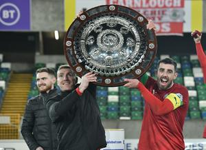 Chris Curran (left) lifts the County Antrim Shield with Joe Gormley.