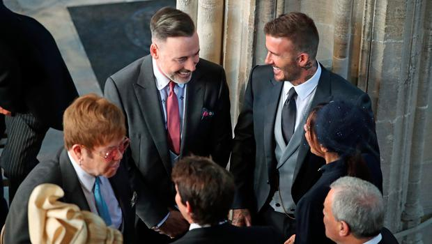 David and Victoria Beckham (both right) talk with Sir Elton John (left) and David Furnish as they arrive in St George's Chapel at Windsor Castle for the wedding of Prince Harry and Meghan Markle. PRESS ASSOCIATION Photo. Picture date: Saturday May 19, 2018. See PA story ROYAL Wedding. Photo credit should read: Danny Lawson/PA Wire