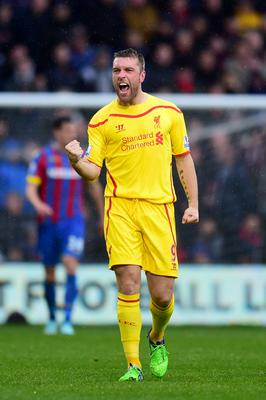 Liverpool's Rickie Lambert celebrates scoring their first goal of the game during the Barclays Premier League match at Selhurst Park, London. Adam Davy/PA Wire.