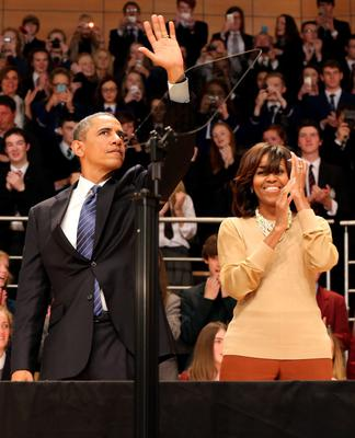 BELFAST, UNITED KINGDOM - JUNE 17:  U.S. President Barack Obama waves next to his wife Michelle Obama, after he delivered a keynote address at the Waterfront Hall ahead of the G8 Summit on June 17, 2013 in Belfast, Northern Ireland. Later The President will join other leaders at the G8 Summit in Fermanagh.  (Photo by Paul Faith - WPA Pool/Getty Images)
