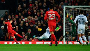Liverpool's Welsh striker Ben Woodburn (L) scores his team's second goal during the English League Cup quarter-final football match between Liverpool and Leeds United at Anfield in Liverpool, north west England on November 29, 2016. AFP/Getty Images