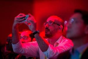 An audience member watches the LG press conference at the 2017 Consumer Electronics Show (CES) in Las Vegas, Nevada on January 4, 2017.  / AFP PHOTO / DAVID MCNEWDAVID MCNEW/AFP/Getty Images