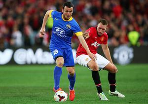 SYDNEY, AUSTRALIA - JULY 20:  Mark Bridge of the All-Stars competes with Phil Jones of Manchester United during the match between the A-League All-Stars and Manchester United at ANZ Stadium on July 20, 2013 in Sydney, Australia.  (Photo by Brendon Thorne/Getty Images)