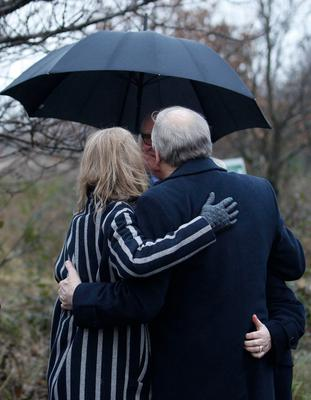 People comfort each other during the memorial service at the site of the Teebane massacre in Co Tyrone ahead of next week's 25th anniversary of the killings.  Eight men died and six others were injured when the IRA exploded a roadside bomb on 17 January 1992.  Those caught up in the attack were all construction workers traveling in a van on their way home from Omagh.  Photo by Peter Morrison/Press Eye.