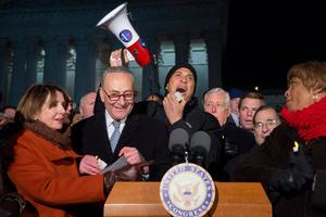 US Senator Cory Booker (C), Democrat of New Jersey, speaks alongside Senate Minority Leader Chuck Schumer (2nd L), Democrat of New York, US House Democratic Leader Nancy Pelosi (L) and other members of Congress as demonstrators protest against US President Donald Trump and his administration's ban of travelers from 7 countries by Executive Order, during a rally outside the US Supreme Court in Washington, DC, on January 30, 2017. Trump's executive order suspended the arrival of all refugees for at least 120 days, Syrian refugees indefinitely -- and bars citizens from Iran, Iraq, Libya, Somalia, Sudan, Syria and Yemen for 90 days.  Protests are taking place at airports across the country in opposition to the ban. / AFP PHOTO / SAUL LOEBSAUL LOEB/AFP/Getty Images