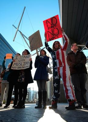 People hold up placards to protest against US President Donald Trump's executive order suspending the resettlement of refugees and banning people from seven majority-Muslim countries from entry into the US, during a rally near the US embassy in Tokyo on January 31, 2017. Some 40 foreigners living in Japan participated in the rally, as a defiant US President Trump struggled to defuse a mounting backlash over his ban on immigrants from seven Muslim-majority nations. / AFP PHOTO / KAZUHIRO NOGIKAZUHIRO NOGI/AFP/Getty Images