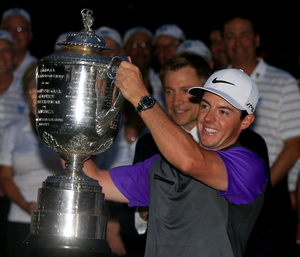 Rory McIlroy of Northern Ireland celebrates with the Wanamaker trophy