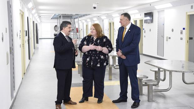 Justice Minister Naomi Long has visiting Maghaberry Prison. Accompanied by Ronnie Armour (left), Director General of the Northern Ireland Prison Service, and David Kennedy (right), Maghaberry Governor. Picture: Michael Cooper