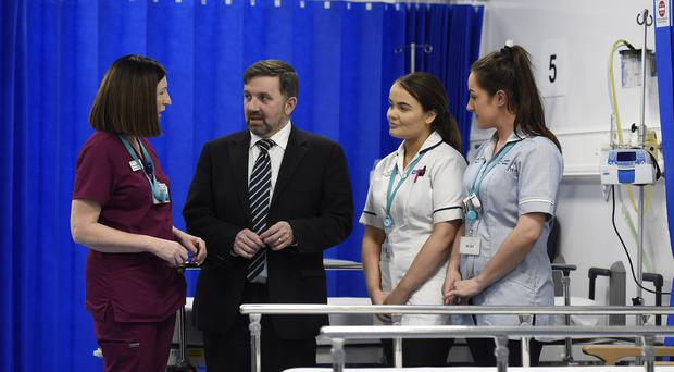 Health Minister Robin Swann with medical staff during a visit to the Antrim Area Hospital, Northern Ireland. Picture: Michael Cooper