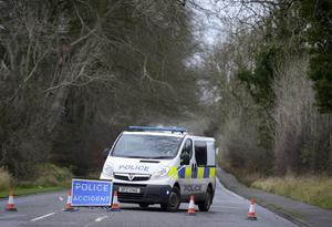 Police near the scene of the crash which claimed the life of a 56-year-old man. Pic: Colm Lenaghan/Pacemaker Press.