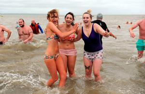 Swimmers take to the Solent as they take part in the Gosport and Fareham Inshore Rescue Service Annual New Year's Day Swim in Gosport, Hampshire.