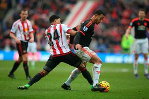 SUNDERLAND, ENGLAND - FEBRUARY 13:  DeAndre Yedlin of Sunderland vies with Memphis Depay of Manchester United during the Barclays Premier League match between Sunderland and Manchester United at The Stadium of Light on February 13, 2016 in Sunderland, England. (Photo by Ian MacNicol/Getty images)