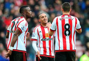 SUNDERLAND, ENGLAND - FEBRUARY 13:  Lamine Kone, Wahbi Khazri and Jack Rodwell of Sunderland celebrate at full time during the Barclays Premier League match between Sunderland and Manchester United at The Stadium of Light on February 13, 2016 in Sunderland, England. (Photo by Ian MacNicol/Getty images)