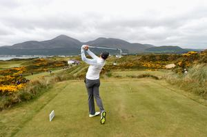 NEWCASTLE, NORTHERN IRELAND - MAY 27:  Rory McIlroy of Northern Ireland tees off on the 4th hole during the Pro-Am round prior to the Irish Open at Royal County Down Golf Club on May 27, 2015 in Newcastle, Northern Ireland.  (Photo by Ross Kinnaird/Getty Images)