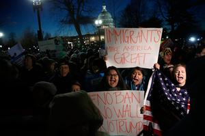 WASHINGTON, DC - JANUARY 30:  Protesters demonstrate as Senate Minority Leader Chuck Schumer (D-NY) and House Minority Leader Nancy Pelosi (D-CA) lead members of Congress in  a protest on the steps of the U.S. Supreme Court January 30, 2017 in Washington, DC. Members of Congress joined refugees, immigrants and members of the Washington DC community in protesting  the Trump administration's recent executive order banning immigration from seven predominantly Muslim countries.  (Photo by Win McNamee/Getty Images)