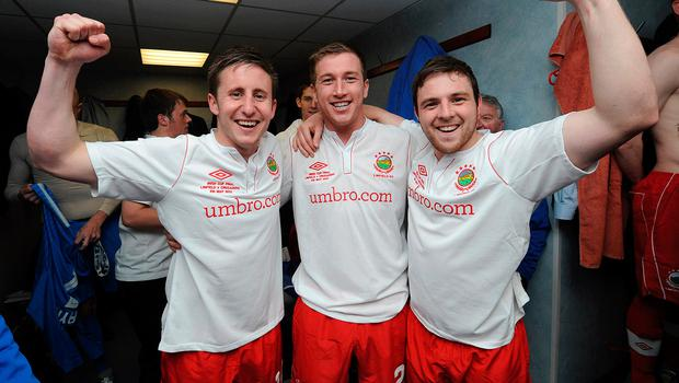 Michael Carvill hailing Linfield's 2012 Irish Cup final win with Mark McAllister and Jamie Mulgrew