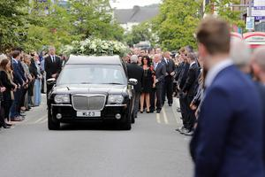 Mourners line the road for the funeral of Newry businessman Brian Conlon (Photo by Paul McErlane for the Belfast Telegraph)