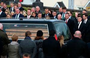 Former Ireland player Brian O'Driscoll (right) looks on as Anthony Foley's coffin arrives at St Flannan's Church, Killaloe, Co. Clare.