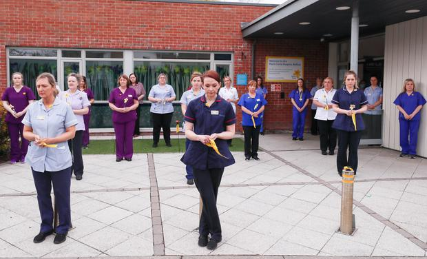 Staff of Marie Curie Hospice in Belfast take part in the minute's silence