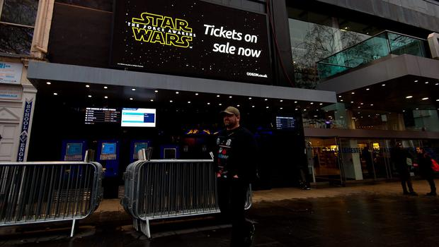 LONDON, ENGLAND - DECEMBER 15:  A fan wearing a Star Wars themed Christmas jumper arrives in Leicester Square to collect his fan pass ahead of the European film premiere of Star Wars: The Force Awakens on December 15, 2015 in London, England. The film starring members of the original cast including  Harrison Ford, Mark Hamill, Carrie Fisher is the seventh film in the Star Wars franchise and is directed by . J. Abrams.  (Photo by Ben Pruchnie/Getty Images)