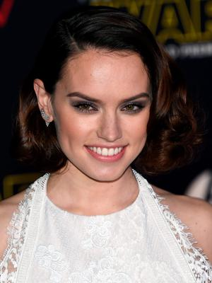 """HOLLYWOOD, CA - DECEMBER 14:  Actress Daisy Ridley attends the premiere of Walt Disney Pictures and Lucasfilm's """"Star Wars: The Force Awakens"""" at the Dolby Theatre on December 14, 2015 in Hollywood, California.  (Photo by Ethan Miller/Getty Images)"""