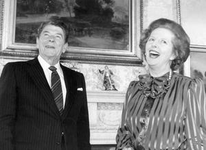 1984:  (FILE PHOTO)  Baroness Margaret Thatcher, 85, Britain's Prime Minister from 1979 to 1990, Reports on April 8, 2013 state that Baroness Thatcher has died following a stroke..   British Prime Minister Margaret Thatcher shares a joke with American President Ronald Reagan, at No. 10 Downing Street, on June 5, 1984 in London, England.    (Photo by Keystone/Getty Images)