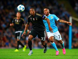 MANCHESTER, ENGLAND - SEPTEMBER 15:  Patrice Evra of Juventus holds off Raheem Sterling of Manchester City during the  UEFA Champions League Group D match between Manchester City FC and Juventus at the Etihad Stadium on September 15, 2015 in Manchester, United Kingdom.  (Photo by Alex Livesey/Getty Images)