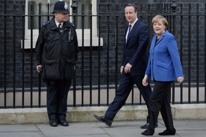 Prime Minister David Cameron welcomes German Chancellor Angela Merkel ahead of press conference