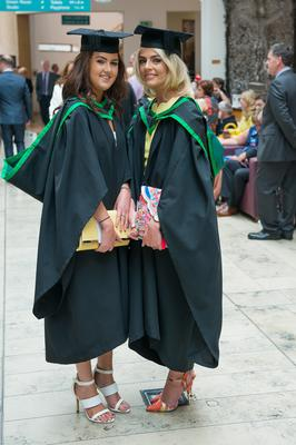 No Fee for Reproduction  Graduating from the Ulster University today with a degree in Business  are,  Sarah Buchanan and Mary Cusack from Derry. fPicture Martin McKeown. Inpresspics.com. 20.06.15